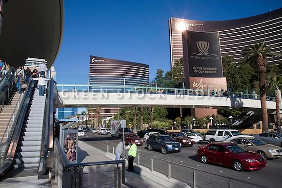 Cars driving under a pedestrian bridge at Las Vegas Boulevard,  between Fashion Show Mall and the Encore Wynn Las Vegas hotel. Las Vegas, Nevada, USA