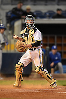 Vanderbilt Commodores catcher Karl Ellison (25) checks the runner at first during a game against the Indiana State Sycamores on February 20, 2015 at Charlotte Sports Park in Port Charlotte, Florida.  Vanderbilt defeated Indiana State 3-2.  (Mike Janes/Four Seam Images)