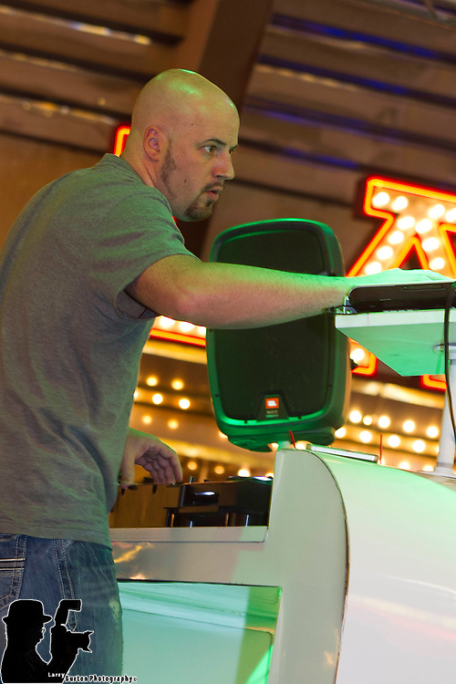 Local DJ plays on 3RD Street Stage
