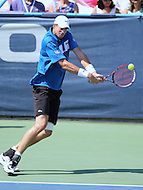 Washington, DC - August 9, 2015: John Isner (USA) hits a backhand shot during the ATP Citi Open final at Rock Creek Park Tennis Center in Washington, DC  August 9, 2015.  (Photo by Elliott Brown/Media Images International)