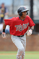 Third baseman Jonatan Hinojosa (7) of the Elizabethton Twins in a game against the Johnson City Cardinals on Sunday, July 27, 2014, at Howard Johnson Field at Cardinal Park in Johnson City, Tennessee. The game was suspended due to weather in the fifth inning. (Tom Priddy/Four Seam Images)