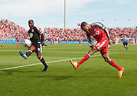 05 May 2012: Toronto FC foward/midfielder Ryan Johnson #9 and D.C. United defender/midfielder Brandon McDonald #4 in action during an MLS game between DC United and Toronto FC at BMO Field in Toronto..D.C. United won 2-0.