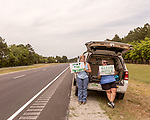 May 5, 2018. Fayetteville, North Carolina.<br /> <br /> (left to right) Katie Gallagher and Debra Grabauskas hold signs about the GenX pollution of the Cape Fear River on Hwy. 87 just outside the Chemours plant which has been dumping GenX unregulated into the river for years. <br /> <br /> The Chemours Company, a spin off from DuPont, manufactures many chemicals at its plant in Fayetteville, NC. One of these, commonly referred to as GenX, is part of the process of teflon manufacturing. Chemours has been accused of dumping large quantities of GenX into the Cape Fear River and polluting the water supply of city's down river and allowing GenX to leak into local aquifers.