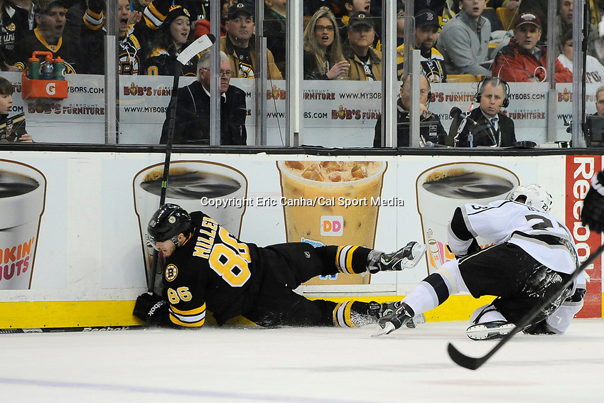 January 20, 2014 - Boston, Massachusetts, U.S. - Boston Bruins defenseman Kevan Miller (86) goes into the boards during the NHL game between Los Angeles Kings and the Boston Bruins held at TD Garden in Boston Massachusetts. The Bruins defeated the Kings 3-2 in regulation time.   Eric Canha/CSM