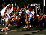Michael Beasley (30) is defended by Rick Jackson (40) during the Elite 24 Hoops Classic game on September 1, 2006 held at Rucker Park in New York, New York.  The game brought together the top 24 high school basketball players in the country regardless of class or sneaker affiliation.