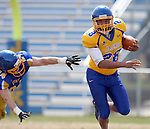 BROOKINGS, SD - APRIL 26:  Bridgeport Tusler #28 from South Dakota State's offense gets past Nick Farina #24 from the defense during their spring game Saturday at Coughlin Alumni Stadium in Brookings. (Photo by Dave Eggen/Inertia)