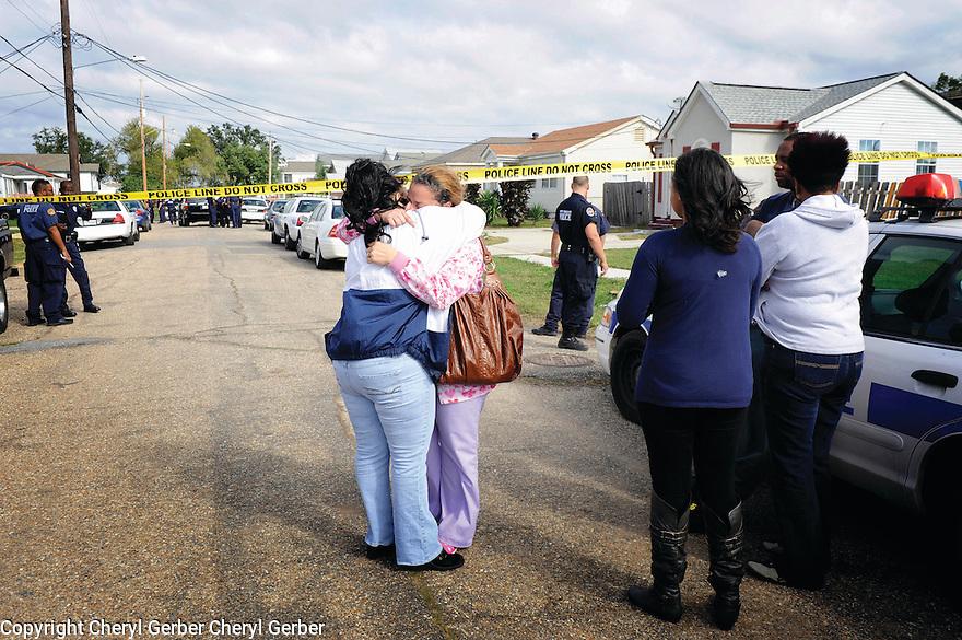 Two women embrace near a murder scene in Gentilly, 2009