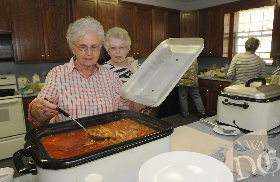 NWA Democrat-Gazette/FLIP PUTTHOFF <br /> READY FOR LUNCH<br /> Katie Rieff (left) and Rheta Van Doren stir home-made stew Wednesday Oct. 14 2015 during the Holiday Bazaar at  Brightwater Memorial United Methodist Church on U.S. 62 north of Avoca. The bazaar continues today from 7:30 a.m. to 3 p.m. A lunch of stew or ham and beans is available from 11:30 a.m. to 1 p.m. Items for sale include home-made pies, breads, jellies and other treats, along with crafts and used goods.