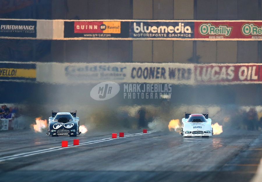 Feb 13, 2016; Pomona, CA, USA; NHRA funny car driver John Hale (left) races alongside Jim Campbell during the Winternationals at Auto Club Raceway at Pomona. Mandatory Credit: Mark J. Rebilas-USA TODAY Sports
