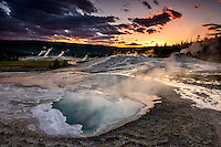Heart Spring in Yellowstone's Upper Geyser Basin at sunset.