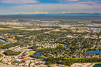 Aerial view of the city of Fairbanks situated in the Tanana valley flats, the Alaska Range mountains visible on the distant horizon.