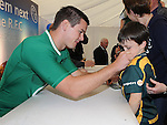 Saul Carolan Maher get his jersey signed by Irish international rugby star Johnny Sexton at the training day at Boyne RFC. Photo: Colin Bell/pressphotos.ie