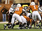 Texas Longhorns defensive tackle Kheeston Randall (91) and Texas Longhorns linebacker Keenan Robinson (1) in action during the Texas A & M vs. Texas Longhorns football game at the Darrell K Royal - Texas Memorial Stadium in Austin, Tx. Texas A & M defeats Texas 24 to 17....