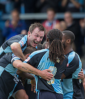 Michael Harriman of Wycombe Wanderers celebrates with teammates after scoring his first goal during the Sky Bet League 2 match between Wycombe Wanderers and Hartlepool United at Adams Park, High Wycombe, England on 5 September 2015. Photo by Andy Rowland.