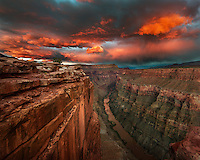 The afterglow of the setting sun illuminates the Colorado River under Toroweap, a remote location in the Grand Canyon. <br />