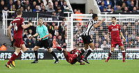 Liverpool's Georginio Wijnaldum goes down under the challenge from Newcastle United's Isaac Hayden<br /> <br /> Photographer Rich Linley/CameraSport<br /> <br /> The Premier League -  Newcastle United v Liverpool - Sunday 1st October 2017 - St James' Park - Newcastle<br /> <br /> World Copyright &copy; 2017 CameraSport. All rights reserved. 43 Linden Ave. Countesthorpe. Leicester. England. LE8 5PG - Tel: +44 (0) 116 277 4147 - admin@camerasport.com - www.camerasport.com
