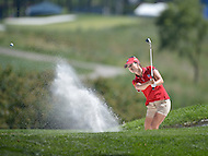 Owings Mills, MD - July 26, 2014: Beatriz Recari, of Team Spain, chips from the bunker on the 9th hole during Round 3 of four-ball competition at the LPGA International Crown at the Caves Valley Golf Club in Owings Mills, MD on July 26, 2014. 32 players from twelve countries competed in this inaugural tournament.  (Photo by Don Baxter/Media Images International)