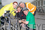 REPAIR: Given Graham Harris to repair his bike before the 50k Ballyheigue cycle to raidse funds for the ballyheigue Rowing Club on Saturday, L-r: Ann Meehan (Ballybunion), Padraig Dineen (Abbeydorney), Clive Pulman (Kilflynn) and Graham Harris.