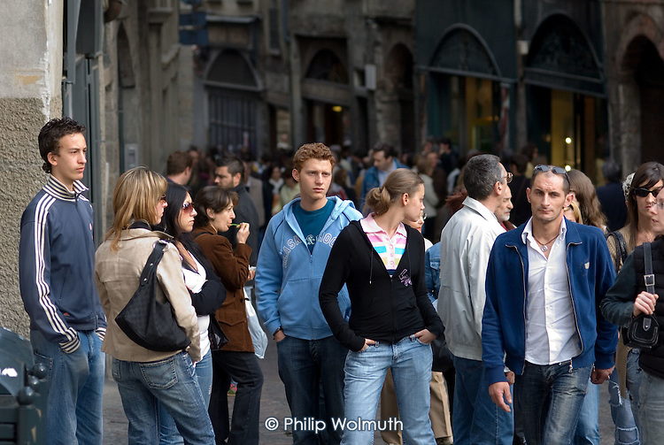 Young people on a crowded street in Bergamo