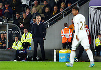 Swansea City manager Garry Monk issues instructions to Kyle Naughton during the Capital One Cup match between Hull City and Swansea City played at the Kingston Communications Stadium, Hull