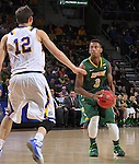 SIOUX FALLS, SD - MARCH 8:  Carlin Dupree #3 of North Dakota State readies his shot over Keaton Moffatt #12 of South Dakota State during the 2016 Summit League Championship Game Tuesday at the Denny Sanford Premier Center in Sioux Falls, S.D. (Photo by Dick Carlson/Inertia)