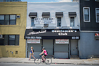 A bar seen in the Long Island City neighborhood  in Queens in New York on Saturday, June 15, 2013. (© Frances M. Roberts)
