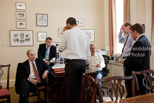 White House aides, from left, Phil Schiliro, Sean Sweeney, Rahm Emanuel, Jim Messina, and DanTurton, listen as President Barack Obama talks on the phone with a Member of Congress in the Chief of Staff 's office at the White House, Sunday, March 21, 2010. .Mandatory Credit: Pete Souza - White House via CNP