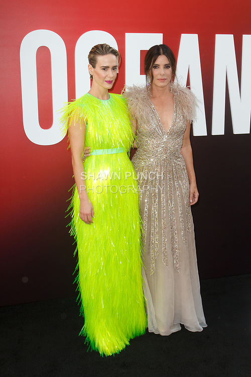 Sarah Paulson (left) and Sandra Bullock arrive at the World Premiere of Ocean's 8 at Alice Tully Hall in New York City, on June 5, 2018.