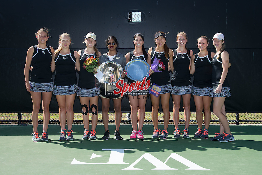 The Wake Forest Demon Deacons recognized seniors Akina Anand (manager) and Karen Forman prior to their match against the North Carolina State Wolfpack at the Wake Forest Tennis Center on April 11, 2015 in Winston-Salem, North Carolina.  The Demon Deacons defeated the Wolfpack 4-3.    (Brian Westerholt/Sports On Film)