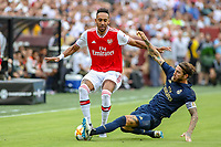 Landover, MD - July 23, 2019: Real Madrid Daniel Carvajal (2) makes a sliding tackle on Arsenal Pierre-Emerick Aubameyang (14) during the match between Arsenal and Real Madrid at FedEx Field in Landover, MD.   (Photo by Elliott Brown/Media Images International)