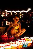 VIETNAM, Hoian, little girl sitting behind paper lanterns during Tet Holiday