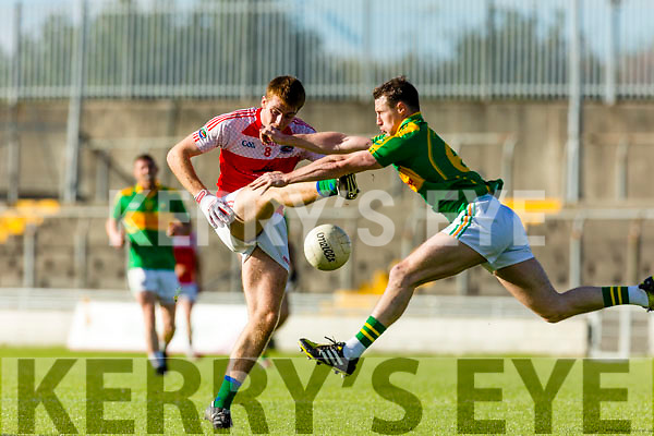 Mark Griffin South Kerry in action against Barry O'Sullivan Dingle in the Quarter Finals of the Kerry County Football Championship at Austin Stack Park on Saturday.