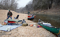 NWA Democrat-Gazette/DAVID GOTTSCHALK Bob Kramer sets his cot for the night Thursday, February 8, 2018, on the bank of the Meramec River. Eight paddlers from the Fayetteville area spent February 2-10, 2018 floating 46 miles of the spring fed river in Missouri.