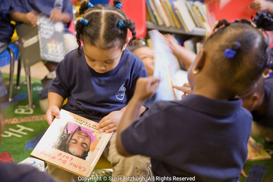 Looking at books at the Clear Head Learning Center, New Orleans LA: