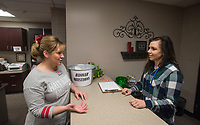 NWA Democrat-Gazette/BEN GOFF @NWABENGOFF<br /> Principal Shannon Passmore (left) checks in Meredith Miller from Ozark Guidance Friday, March 9, 2018, in the main office at Lowell Elementary.