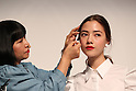 "September 21, 2016, Tokyo, Japan - Japan's cosmetics giant Shiseido chief professional make-up artist Miyako Okamoto (L) gives a make-up to a model as the company will launch the new make-up brand ""Playlist"" in Tokyo on Wednesday, September 21, 2016. Playlist is developed by Shiseido's professional make-up artists and users will be able to have web counselling and make-up tips through the Internet.   (Photo by Yoshio Tsunoda/AFLO) LWX -ytd-"