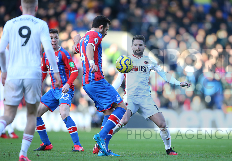 Sheffield United's Oliver Norwood and Crystal Palace's Luka Milivojevic during the Premier League match at Selhurst Park, London. Picture date: 1st February 2020. Picture credit should read: Paul Terry/Sportimage