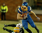 BROOKINGS, SD - OCTOBER 3:  Brady Mengarelli #44 from South Dakota State slips the tackle of Jason Allison #21 from North Dakota State in the second quarter of their game Saturday night at Coughlin Alumni Stadium in Brookings. (Photo by Dave Eggen/Inertia)