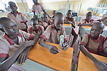 Students learn about electricity with a hand-cranked generator and light bulb in the Loreto Primary School in Rumbek, South Sudan. The Loreto Sisters began a secondary school for girls in 2008, with students from throughout the country, but soon after added a primary in response to local community demands.