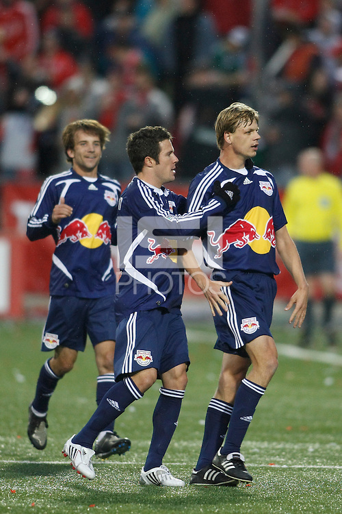 New York Red Bulls midfielder Dave van den Bergh (11)  celebrates scoring with defender Hunter Freeman (3) and midfielder Mike Magee (7) during a Major League Soccer match against Toronto FC at BMO Field in Toronto, Ontario, Canada, on May 1, 2008.