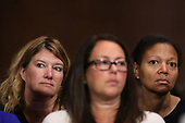 WASHINGTON, DC - SEPTEMBER 27:  Attendees listen to Christine Blasey Ford as she testifies before the Senate Judiciary Committee in the Dirksen Senate Office Building on Capitol Hill September 27, 2018 in Washington, DC. A professor at Palo Alto University and a research psychologist at the Stanford University School of Medicine, Ford has accused Supreme Court nominee Judge Brett Kavanaugh of sexually assaulting her during a party in 1982 when they were high school students in suburban Maryland.  (Photo by Win McNamee/Getty Images)
