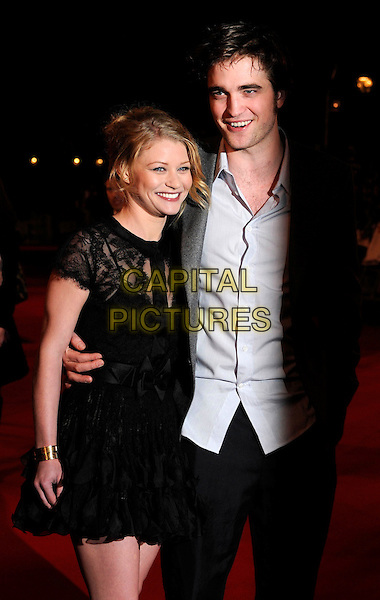 """EMILIE DE RAVIN & ROBERT PATTINSON .""""Remember Me"""" UK Film Premiere - Arrivals held at Odeon cinema, Leicester Square, London, England..March 17th 2010 .half length black lace dress sheer see through thru bow s arm around grey gray jacket blazer blue shirt ruffle ruffles trousers rob smiling.CAP/CAN.©Can Nguyen/Capital Pictures."""