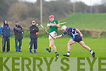 Kerry's Brendan O'Leary goes for the point as IT Tralee's  Anthony Fealy tries to stop him in the Waterford Crystal Cup at Abbeydorney on Sunday..