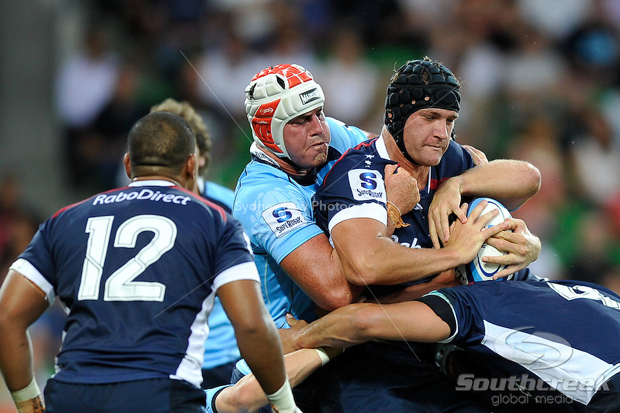 Kevin O'Neill of the Rebels protects the ball during the week one match of the 2011 Super 15 Rugby tournament between Melbourne Rebels and Waratahs at AAMI Park, Melbourne, Australia...This image is not for sale on this web site. Please contact Southcreek Global Media for licensing:.Toll Free: 1.800.934.5030.Canada: 701 Rossland Rd. East, Suite 315, Whitby, Ontario, Canada, L1N 9K3.USA: 10792 Baron Dr, Parma OH, USA 44130.Web: http://southcreekglobal.net/ and http://southcreekglobal.com/