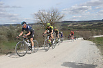 The peloton give chase on sector 8 Monte Santa Maria during Strade Bianche 2019 running 184km from Siena to Siena, held over the white gravel roads of Tuscany, Italy. 9th March 2019.<br /> Picture: Eoin Clarke | Cyclefile<br /> <br /> <br /> All photos usage must carry mandatory copyright credit (&copy; Cyclefile | Eoin Clarke)