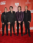 LOS ANGELES, CA - FEBRUARY 10: (L-R) Musicians Josh Jove, Jacob Pilot, Chase Simpson and Sebastian Harris of the Shelters attend MusiCares Person of the Year honoring Tom Petty at the Los Angeles Convention Center on February 10, 2017 in Los Angeles, California.