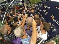 July 24, 2014 - Foxborough, Massachusetts, U.S.- New England Patriots quarterback Tom Brady (12) is swarmed  by media on the first day of the New England Patriots training camp held at Gillette Stadium in Foxborough Mass.Eric Canha/CSM