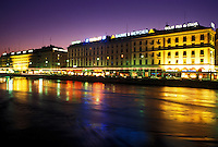 Geneva, Rhone River, Switzerland, Buildings along the Rhone River in downtown Geneva at night.
