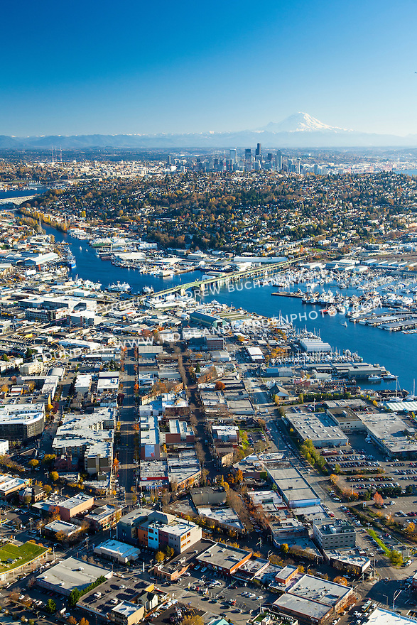 Aerial photo of the Lake Washington Ship Canal with the Seattle skyline and Mount Rainier in the background