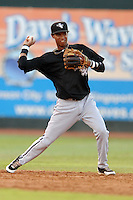 Bristol White Sox shortstop Jeffry Santos #8 fields and throws to first during a game against the Johnson City Cardinals at Howard Johnson Field on August 19, 2013 in Johnson City, Tennessee. The White Sox won the game 5-4. (Tony Farlow/Four Seam Images)